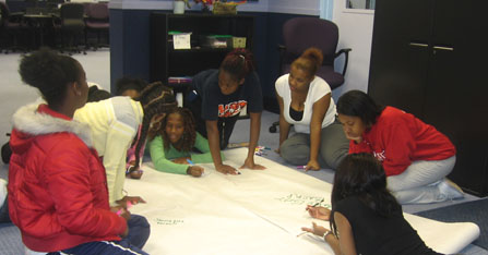 Girls working on poster